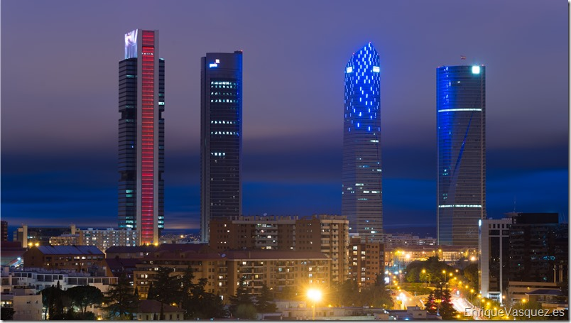 Madrid cityscape at night. Landscape of Madrid business building at Four Tower. Modern high building in business district area at Spain.